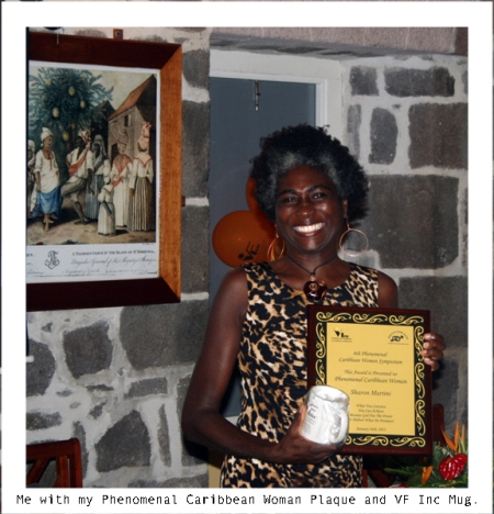 Sharon Martini proud as punch with Phenomenal Caribbean Woman Plaque